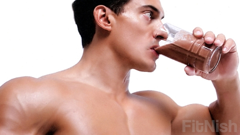 Fit guy drinking protein shake