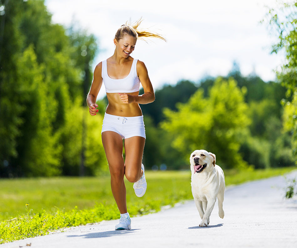 fit girl running with her dog