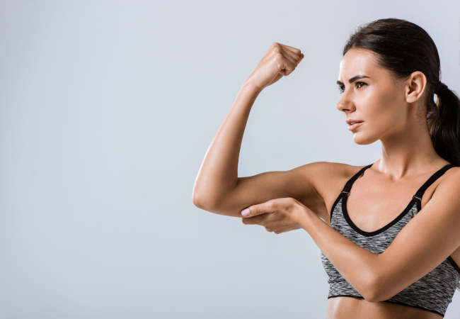 girl fitness hold tricep