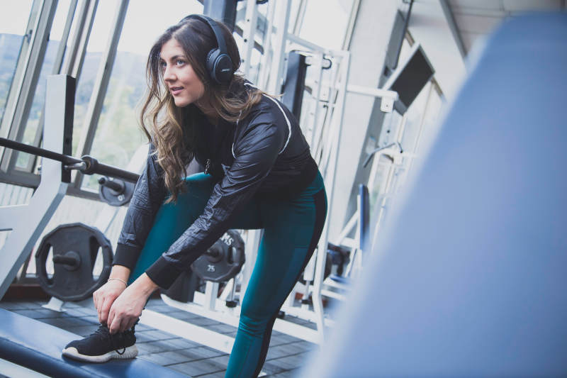 girl headphones fitness gym