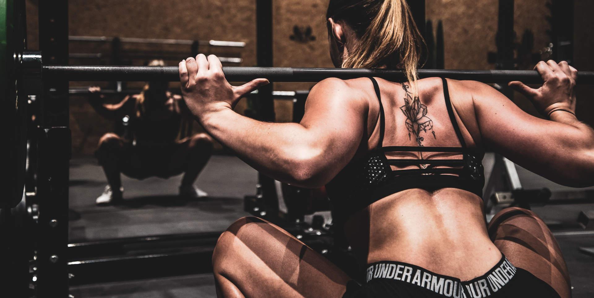 girl squatting fitness gym